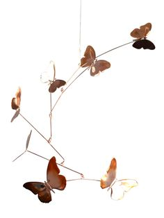 Butterfly Mobile - Handmade Copper.  This captivating mobile may be hung indoors or outside. Indoors, the shiny copper reflects dapples of light. Outdoors, the copper will age to a dark brown followed by the traditional copper patina.