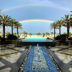 Double rainbow over the pool deck of Omni Amelia Island Plantation  Photo by @carlin.aquino  #doublerainbow #pooldeck #infinitypool #palmtrees #ameliaisland #florida #travel