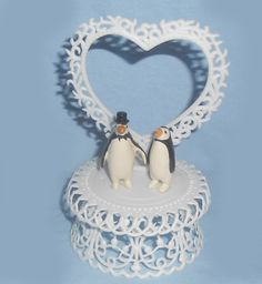 Our cool and classy penguin wedding cake topper, will help add a special touch of unique penguin passion to your wedding cake, and help you celebrate in style after you waddle down the aisle. Our pair