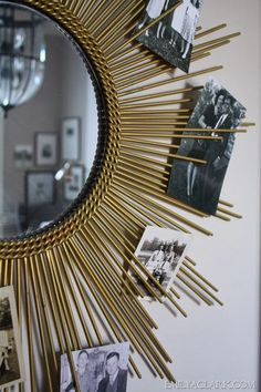 This sunburst mirror photo display is a great way to showcase old black-and-white photographs.
