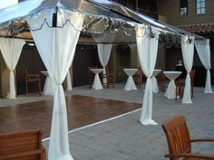 This is pretty and unobtrusive  http://www.alliesparty.com/images/clear_top_canopy_large.jpg