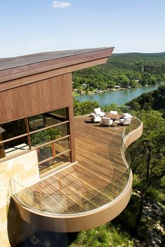Located on a steeply-sloping, wedge-shaped site that opens to sweeping views of a canyon, Lake Austin and the Hill Country beyond, this residence was designed by Miró Rivera Architects