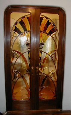 DESIGN by Sean Jenan, from the original design in the Chrysler Building, New York City DOORS are American Black Walnut with Ultra-Platinum Shellac, hand rubbed and waxed. Glass was done by Darsey Kuster of A Touch of Stained Glass. Hardware by Crown City Hardware.