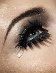 Bold and dramatic black eye makeup with false lashes both top and bottom lashes - pretty photo with tear