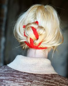 I like tying my hair up with a piece of fabric- no pony tail bump, and it can make your up-do look more full and less skimpy. I also do this when my hair is wet in the summer and it dries in nice wavy curls.