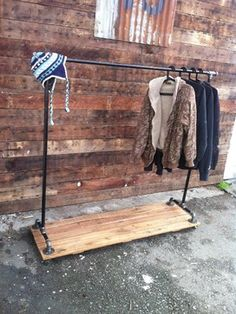 Houzz. Clothing rack made from cast iron pipe with reclaimed wood base on 4 locking casters.