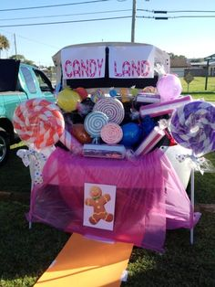 This is how my Trunk or Treat Candyland Turned out! - Pool Noodles for the Lollipops & hard candy, just taped with white duct tape from BigLots & stuck on mop handles from the Dollar Store. Balloons wrapped in cellophane wrap from the Dollar Store.
