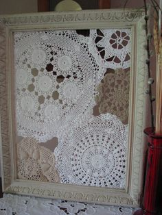 my weekend upcycle project...repurposed doilies and wood frame...love it as a wall hanging, but will likely use it to organize my earrings.