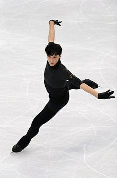 Johnny Weir (USA) – Underneath the flamboyant costumes is a solid skater. Weir's mental competitiveness has returned this season, but recent talk of the quad may be just that; he's never landed it cleanly in competition. (Robyn Beck/AFP/Getty Images)