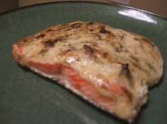 I had baked salmon at a friends house recently.  (She is an Alaskan native and had some salmon she brought back from vacation.  Yummy)  She spread mayo and some seasonings on the fish then baked it.  I had never heard of that before, but it was really good.  I came up with my own twist using that idea.  I made this last night and it was wonderful.  Hope you enjoy!
