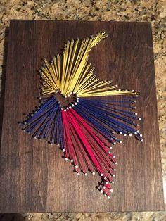 Finally did a diy. Multi color string art. Bogota Colombia. Red yellow blue heart. By Morgan Callard