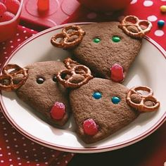 Chocolate Reindeer Cookies Recipe from Taste of Home -- You can enlist little hands to help position the antlers, eyes and noses on these adorable, crisp reindeer cookies. —Pat Habiger, Spearville, Kansas