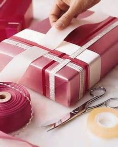 WEAVING RIBBONS:  different sized ribbons + double sided tape = a beautiful package
