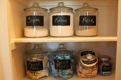 I love how the jars display what you have and what you may need. The chalkboard labels are great and can either be painted on or glued on with special chalkboard paper.    Courtesy Decor Chick