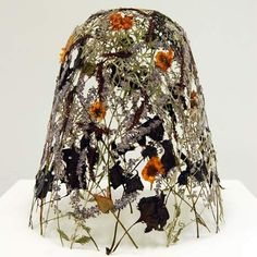 The Fragility of Time by Ignacio Canales Aracil. This delicate sculpture was produced by pressing & drying wild flowers.