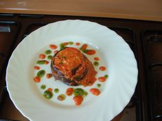 Torteau  de  aubergines au mozzarella tomates  et pesto de basilique  Gino D'Aquino