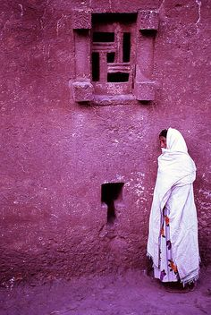 A woman listens to the morning prayers and chants in one of the old churches of Lalibela, Ethiopia, Africa. We Are The World, People Around The World, Around The Worlds, World Of Color, Color Of The Year, Horn Of Africa, Old Churches, Shades Of Purple, Magenta