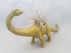 #EndHateosaurus https://www.etsy.com/shop/EndHateosaurus  Golden Up-Cycled Toy Dinosaur Planter