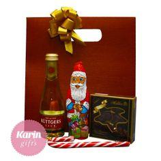 Cadou Sweet Santa este un cadou deosebit cu praline, ciocolata, sampanie si acadea.