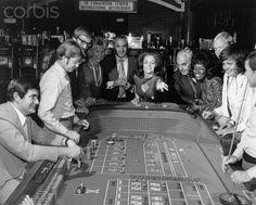 Las Vegas 1960's - Woman Throwing Dice at a Craps Table. Stock Photo - Corbis