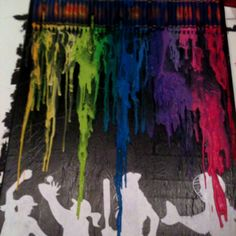 Melted crayons on canvas with modge podged silhouettes