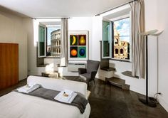 Rome Unique Colosseum Apartments Roma Located in Rome?s city centre, Short Stay Rome Apartments offers contemporary-style apartments with free Wi-Fi access. All apartments are set in Rome's Coliseum and Monti areas.