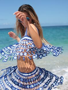 Our Mediteranean inspired Athena mini skirt is enitrely made of individually hand-crocheted evil eye flowers featuring a fitted waistline and side tie that creates a unique glamorous beach look Hand Crochet, Crochet Top, Evil Eye Hand, Thin Hair Cuts, Beach Look, Crochet Clothes, Beachwear, Swimwear, Mini Skirts