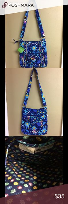 Vera Bradley Disney Dreaming Hipster NWT The front exterior has a slip in pocket and a zippered pocket. The exterior back has a large zippered pocket. The interior has three slip in pockets. It's finished with cute silver buckles and a zippered closure. This comes from a smoke free and pet free home! Vera Bradley Bags Crossbody Bags