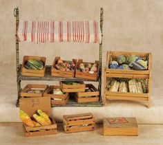 De Kleine Wereld Museum of Lier: 183 German Tin Fruit Stand with Awning by Bing with Crates of Fruits