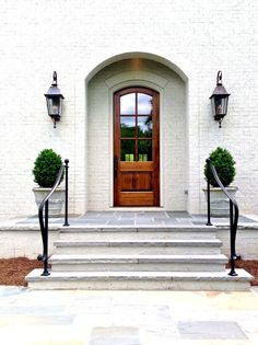Front entry ideas entry traditional with wrought iron railings copper gas lanterns with decorative scrolls ashlar
