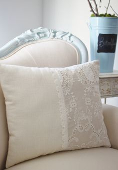 Vintage French cutwork embroidery pillow w/cream and circle fleur design