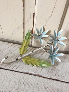 Vintage Italian Tole Flower - Whitewashed Chippy Metal Wall Hook - Pale Blue Aqua - Green Metal Leaves by sewbeautiful2 on Etsy