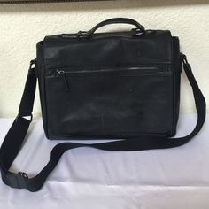 Aldo Messenger Bag My daughter used this for school for a year. Has some scuffs on front and wear at top edges. Still very pretty and useful. 100% Polyurethane. ALDO Bags Laptop Bags