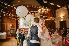 White wedding balloons with gold tassels | Photography by http://www.ellieglillard.co.uk/
