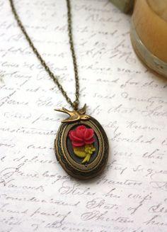 A Tiny Red Rose Flower Flying Bird Swallow Oval Locket by Marolsha, $23.00