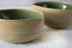 NEW! Ceramic snack bowl. I made this handmade bowl on my pottery wheel with a beige speckled clay. After throwing the bowl I let it dry for a short time and then turned it upside down to trim the base. After this, I coated the inner surface with a glossy semi-transparent green glaze.