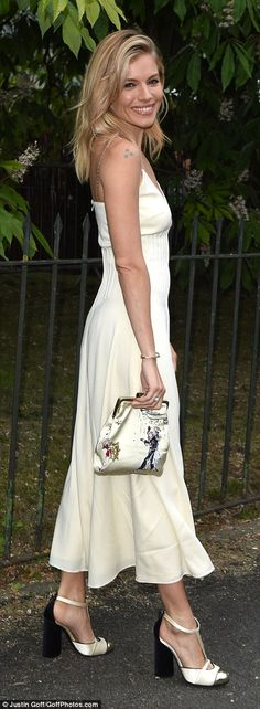 Elegant as ever: The 34-year-old actress looked lovely in a cream coloured silk slip with coordinating accessories