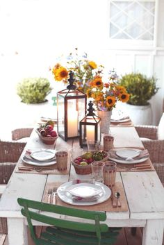 Simple and elegant table setting with sunflower centerpiece.