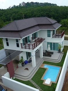 House design - Sea Life Villa is located 400 meters from Long Beach, one of the most beautiful beaches on Koh Lanta The Villa has 3 large bedrooms which sleep 6 guests The bedrooms all have a sea view of the Andam Bungalow House Design, House Front Design, Small House Design, Dream Home Design, Home Design Plans, Modern House Design, House Plans Mansion, Dream House Exterior, Sims House
