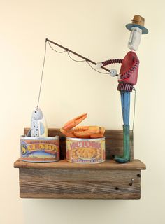 """""""Canned Fish""""by contemporary American folk artist, Jim Dixon. Made from recycled materials. Measures 12"""" x 18"""" x 5″. See it and the full collection at www.jimdixonartist.com"""