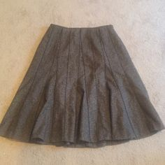 Ann Taylor skirt Flowy Ann Taylor black/brown tweed skirt. Only worn a few times. Covers knee. Ann Taylor Skirts