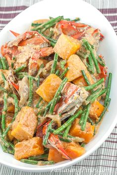 Ginataang Sitaw at Kalabasa is a dish made from String beans, Calabaza Squash, and Blue Crabs. Try this Recipe.