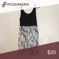 """Forever21 Black and White Dress Medium Brand New with Tags. Jersey bodycon black dress with white chiffon detail """"skirt"""" from the waist. Forever 21 Dresses"""