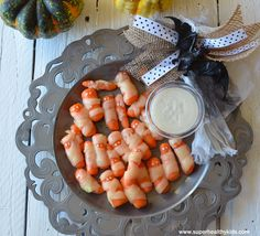 These little carrot mummies are a great substitute for the popular little hot dog mummies! :)  With cheese and ranch they were a hit with my kids!
