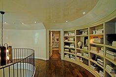 curved foyer upstairs with built-ins