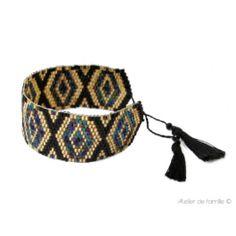 Manchette brésilienne en perles noir, or et bleu