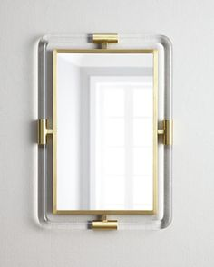 Jonathan Adler Jacques Acrylic Mirror A bit campaign style, a bit nautical, and totally chic, this uber modern mirror blends clear Lucite® with brushed brass accents for an extra airy feel. Made of Lucite® and brass. Hangs vertically or horizontally. Brass Mirror, Acrylic Mirror, Floor Mirror, Mirror Mirror, Wall Mirrors, Mirror Ideas, Mirror Image, Luminaire Design, Jonathan Adler