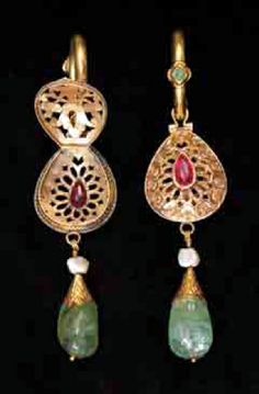 Morocco | Pair of earrings ~ moutaïcha ~ Gold, emeralds and rubies.  The centerpiece opens at the back to accommodate a fragrant paste | Fez, 19th century | Est. 25,000 to 28,000 Dh (Nov '12)