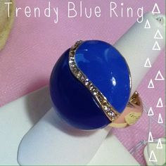 Rhinestone Accented Blue Ring Beautiful blue rhinestone embellished stretch ring in gold metal base. Jewelry Rings
