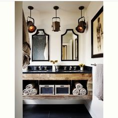 An eclectic bathroom regram from @stylebyyellowbutton - loving those lights, hand picked mirrors and gorgeous recycled timber bench. #thedesignhunter #bathroom #eclectic #interiors #stagelights #lights #lighting #timber